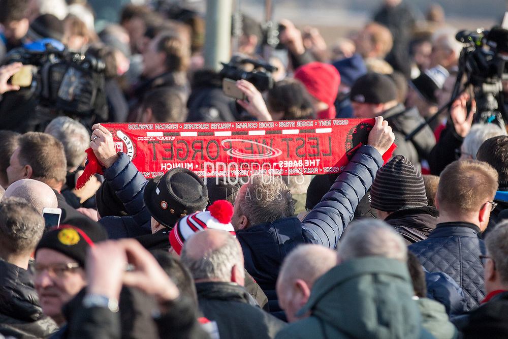 Lest we forget scarf during the ceremony at Manchesterplatz, Munich, Germany. Picture by Phil Duncan.