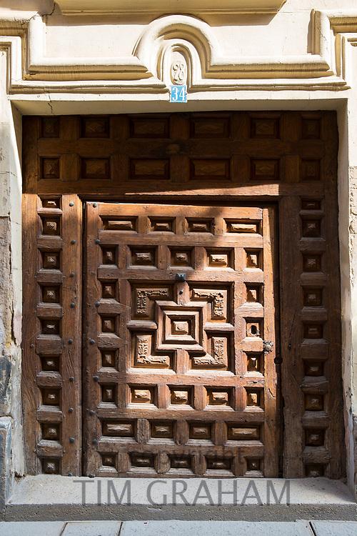 Ancient carved wooden doorway in Santo Domingo de la Calzada in  La Rioja, Spain