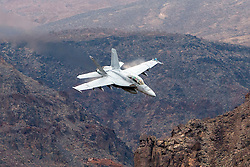 Boeing F/A-18F Super Hornet XE-230 of the US Navy's VX-9 Vampires squadron flies low level through the Star Wars Canyon, Jedi Transition, Sidewinder course, Death Valley National Park, California, United States of America