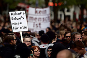 Hamburg | 01 May 2015<br /> <br /> 4000 protesters take part in the &quot;Never Mind The Papers&quot; rally for migrants and refugees in the german city of Hamburg. Picture shows the demonstration march with a placard wich reads &quot;Arbeitserlaubnis f&uuml;r alle&quot; (working permit for everybody).<br /> <br /> &copy;peter-juelich.com<br /> <br /> [Foto honorarpflichtig | Fees Apply | No Model Release | No Property Release]