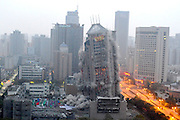 XI\'AN, CHINA - NOVEMBER 15: (CHINA OUT) <br /> <br /> 118-meter-tall Building Blasts Down<br /> <br /> The 118-meter-tall building blasts down on November 15, 2015 in Xi'an, Shaanxi Province of China. The successful explosion of the 118-meter-tall building on Sunday morning in Xi'an made the blast record of the tallest building in China.<br /> ©Exclusivepix Media