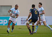 Racing 92 player JOE ROKOCOKO (L) side steps Highlanders player ELLIOT DIXON (c) during the Natixis Cup rugby match between French team Racing 92 and New Zealand team Otago Highlanders at Sui San Wan Stadium in Hong Kong