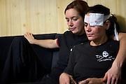 "Molly Kendall, left, comforts crewmate Zin Rain after she was injured by a hard fall when large swells rolled Sea Shepherd's ship, the M/Y Steve Irwin, on Friday, Dec. 16, 2009 in the Southern Ocean.  Some of the greater dangers on campaign come not from clashes with the whaling fleet, but from the simple realities of being at sea. ""Damn it, I just dreamed last night that I was wearing an eye patch!"", said Rain. (Photo by Adam Lau)"