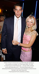 MISS HANNAH SANDLING and MR ARCHIE KESWICK,  at a party in London on 23rd April 2003.PIY 202