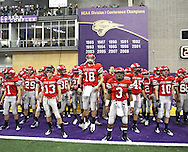 City High quarterback AJ Derby (18) waits with the rest of his team to take the field before their Class 4A semifinal game at the UNI Dome in Cedar Falls on Friday November 13, 2009.