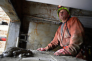 Tony Berg, 58, one of the miners working at the Unity Mine complex is busy fixing the ventilation system, on Wednesday, Apr. 11, 2007, in Cwmgwrach, Vale of Neath, South Wales. The time is ripe again for an unexpected revival of the coal industry in the Vale of Neath due to the increasing prize and diminishing reserves of oil and gas, the uncertainties of renewable energy sources, and the technological advancement in producing energy from coal while limiting emissions of pollutants, has created the basis for valuable investment opportunities and a possible alternative to the latest energy crisis. Unity Mine, in particular, has started a pioneering effort to revive the coal industry in the area, reopening after more than 8 years with the intent of exploiting the large resources still buried underground. Coal could be then answer to both, access to cheaper and paradoxically greener energy and a better and safer choice than nuclear energy as a major supply for the decades to come. It is estimated that coal reserves in Wales amount to over 250 million tonnes, or the equivalent of at least 50 years of energy supply, while the worldwide total coal could last for over 200 years as a viable resource compared to only a few decades of oil and natural gas...