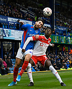 Ben Close (33) of Portsmouth battles for possession with Clarke Oduor (22) of Barnsley during the The FA Cup match between Portsmouth and Barnsley at Fratton Park, Portsmouth, England on 25 January 2020.