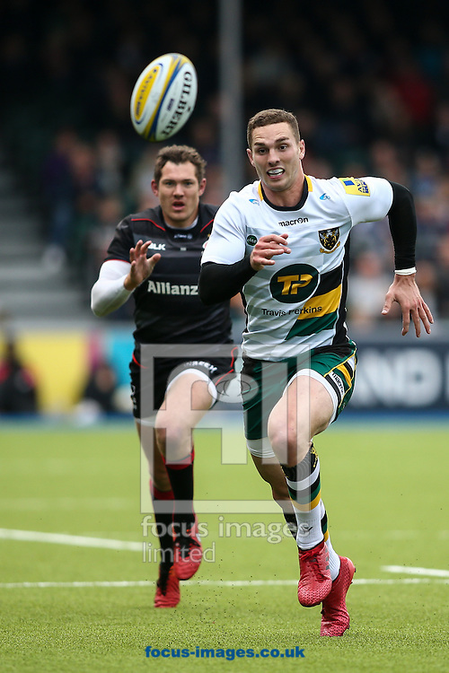 George North of Northampton Saints chasing down a ball with Alex Goode of Saracens (left) in tow during the Aviva Premiership match at Allianz Park, London<br /> Picture by Andy Kearns/Focus Images Ltd 0781 864 4264<br /> 17/09/2016