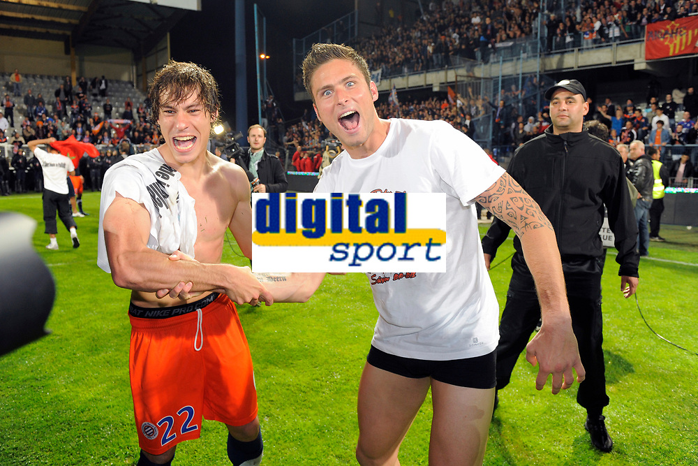 FOOTBALL - FRENCH CHAMPIONSHIP 2011/2012 - L1 - AJ AUXERRE v MONTPELLIER HSC - 20/05/2012 - PHOTO JEAN MARIE HERVIO / DPPI - CELEBRATION BENJAMIN STAMBOULI AND OLIVIER GIROUD (MHSC) AFTER WINNING THE FRENCH CHAMPIONSHIP'S TROPHY