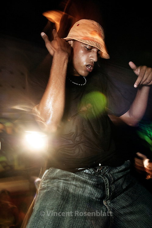 """Show of the """"Piratas"""",  a group  from the favela Mineira,  at the Boquerão ball,  Rio de Janeiro. Diego, one of the 3 dancers.  To enter the Funk scene represents a chance to earn a living and the esteem of tens of thousands of funkeiros, to have a life ahead of fatality, drug trafficking and miserable salaries."""