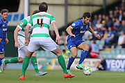 Jon Meades of AFC Wimbledon tries to find a way past Matt Dolan during the Sky Bet League 2 match between Yeovil Town and AFC Wimbledon at Huish Park, Yeovil, England on 12 September 2015. Photo by Stuart Butcher.