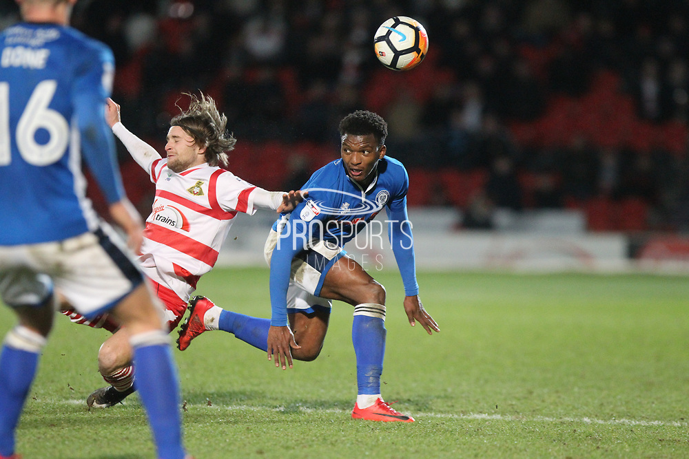Kgosi Nthle wins a header during the The FA Cup 3rd round match between Doncaster Rovers and Rochdale at the Keepmoat Stadium, Doncaster, England on 6 January 2018. Photo by Daniel Youngs.