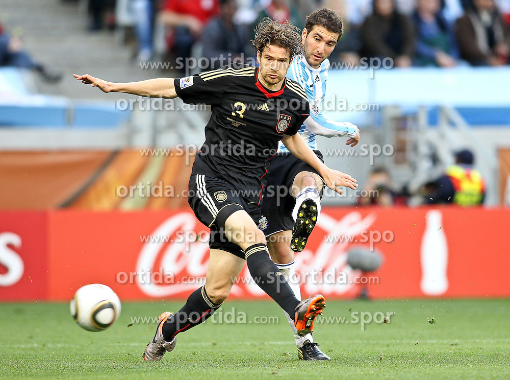 03.07.2010, CAPE TOWN, SOUTH AFRICA, im Bild .Arne Friedrich of Germany attempts to block Gonzalo Higuain of Argentina attempted shot  during the Quarter Final, Match 59 of the 2010 FIFA World Cup, Argentina vs Germany held at the Cape Town Stadium.Foto ©  nph /  Kokenge