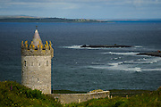 Doolin, Doonagore Castle is a round 16th-century tower house. Doolin is a small seaside village on the northwest coast of County Clare, 8km from the famous cliffs of Moher.