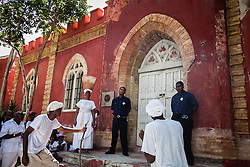 "UVI actors and the Artaura Foundation, Inc. directed by miss Kathleen Pascal reenact a scene of the 1892 Coal Workers' Strike at Fort Christian.  ""Police Officers"" Jahleel Lake and Anthony Petersen, Jr.  7th Annual Dollar Fo' Dollar Culture & History Tour & MIni Coaling Exhibit.  In remebrance of the 1892 Coal Workers Strike on St. Thomas ""livicated"" to Ras Jahstarr Koniyah.  Held annually in September, the tour celebrates the successful protest of 19th centry coal laborers in the streets of downtown Charlotte Amalie for better pay.  Mary Ann Christopher plays the role of Queen Coziah who led the successful revolt.  © Aisha-Zakiya Boyd"
