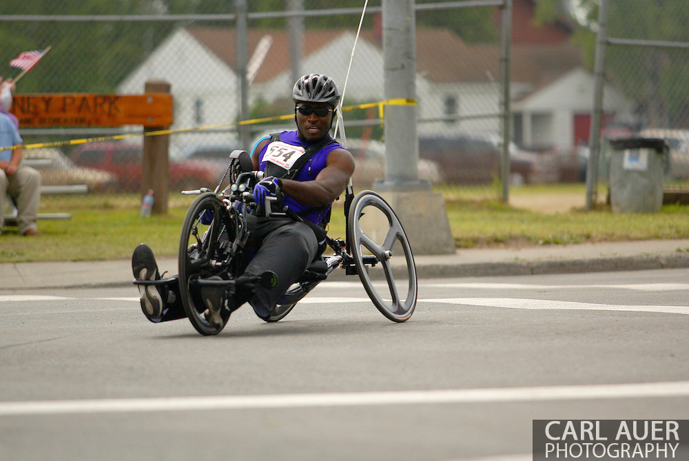 July 4th, 2006:  Anchorage, Alaska - James McGilberry (554), Army veteran from Banning, Calif, enters the first corner of the 5k handcycle event at the 26th National Veterans Wheelchair Games a little too fast, losing control.