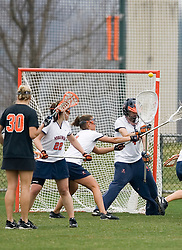 Virginia Cavaliers GK Kendall McBrearty (4) make a save against Princeton.  The Virginia Cavaliers women's lacrosse team defeated the Princeton Tigers 9-7 at Klockner Stadium in Charlottesville, VA on March 24, 2007.