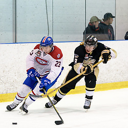 KINGSTON, - Apr 6, 2016 -  Ontario Junior Hockey League game action between Trenton Golden Hawks and Kingston Voyageurs. Game 4 of the North East Championship series.  at the Invista Centre, ON. Jakob Brahaney #23 of the Kingston Voyageurs and Liam Morgan #8 of the Trenton Golden Hawks pursues the play in the first period. (Photo by Ian Dixon / OJHL Images)