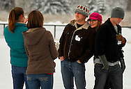 25 DEC. 2010 -- ST. LOUIS -- Annette Rose (center) is joined by her sons Nicholas Holder (left) and Ian Holder for a photograph taken by family friends Kelli Spoede (far left) and Amanda Mayer during a Christmas Day skating session at the Steinberg Skating Rink in Forest Park in St. Louis Saturday, Dec. 25, 2010. The family is from South St. Louis County. Image © copyright 2010 by Sid Hastings.