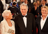 Judi Dench, Stephen Frears and Eddie Izzard at the premiere of the film Victoria & Abdul at the 74th Venice Film Festival, Sala Grande on Sunday 3 September 2017, Venice Lido, Italy.