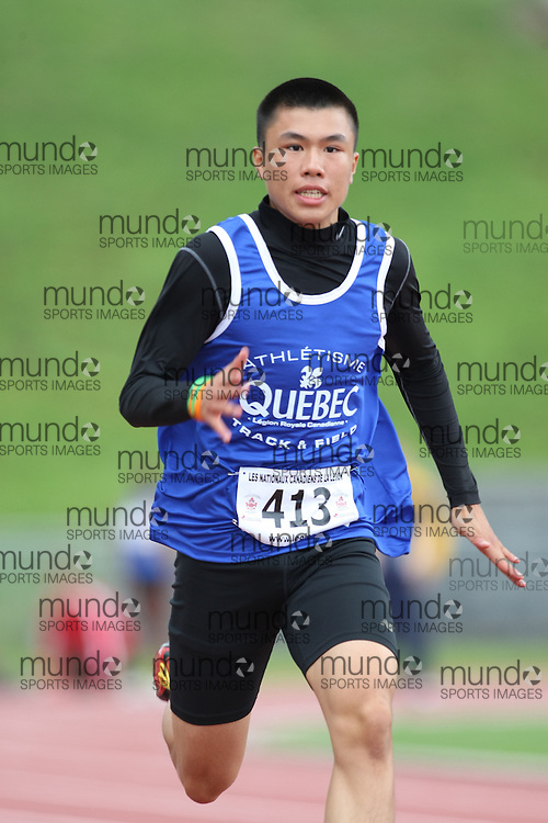 (Sherbrooke, Quebec---10 August 2008) Francis Young competing in the boys 15 and under 100m heats at the 2008 Canadian National Youth and Royal Canadian Legion Track and Field Championships in Sherbrooke, Quebec. The photograph is copyright Sean Burges/Mundo Sport Images, 2008. More information can be found at www.msievents.com.