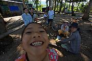 Phu Quoc Island. Bai Thom. Locals opening coconuts.