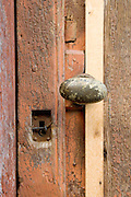 close up of old doorknob with closed up keyhole