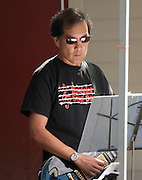 Guitarist Doug Katagiri of the Minidoka Swing Band performs  on the grounds of Washington Country Museum, Hillsboro, Oregon