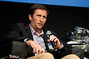 """Alex Mashinsky, Founder and CEO, Governing Dynamics, shares his expertise during the panel, """"Smart Transport, Smart Cities: A Discussion of Smart Urban Technologies."""" Manhattan Chamber of Commerce's Transportation Transformation Global Summit at NYIT in New York on April 26, 2012."""