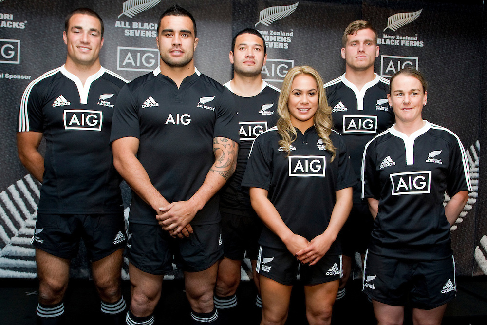 Richard Kahui, left, Liam Messam, Solomon King, Huriana Manuel, Brad Shields, and Emma Jansen  unveil a new global sponsorship deal with AIG Insurance which sees their brand on New Zealand's Representative  Rugby Shirts, Auckland, New Zealand, Friday, October 12, 2012.  Credit:SNPA / David Rowland