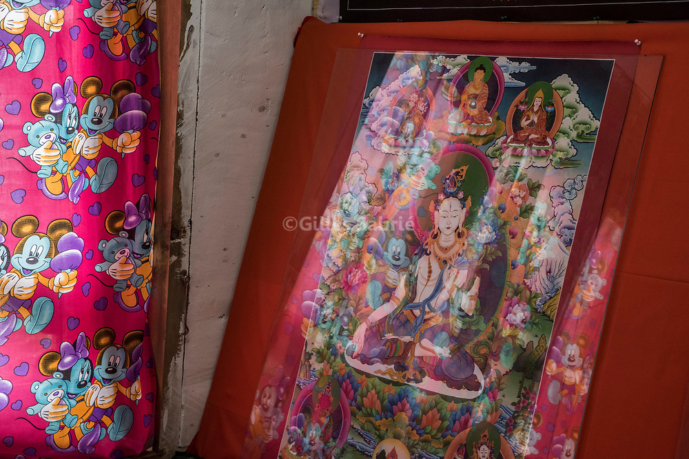 For a story by Steven Lee Myers, Bhutan<br /> Lobesa, Bhutan, August 2nd, 2017<br /> Mickey and Minnie Mouse reflecting on a tank on sale at a souvenir shop in Lobesa village, a popular tourist spot known for the display of phallus wall paintings. <br /> Gilles Sabri&eacute; pour The New York Times