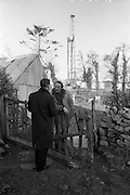02/02/1963<br /> 02/02/1963<br /> 02 February 1963<br /> Ambassador Oil drilling site, Glengevlin, Dowra, Co. Cavan. With the rig looking somewhat out of place in its farmyard setting, Lord Kilbracken chats with an oil Technician. (original caption)