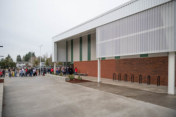 Students walk outside toward a ribbon cutting ceremony in the new gymnasium at Eastwood Elementary School in Hillsboro, Ore., on Tuesday, Feb. 4, 2020.