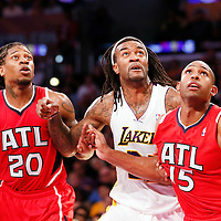 03 November 2013: Los Angeles Lakers center Jordan Hill (27) vies for the rebound with Atlanta Hawks center Al Horford (15) and Atlanta Hawks small forward Cartier Martin (20) during the Los Angeles Lakers 105-103 victory over the Atlanta Hawks at the Staples Center, Los Angeles, California, USA.