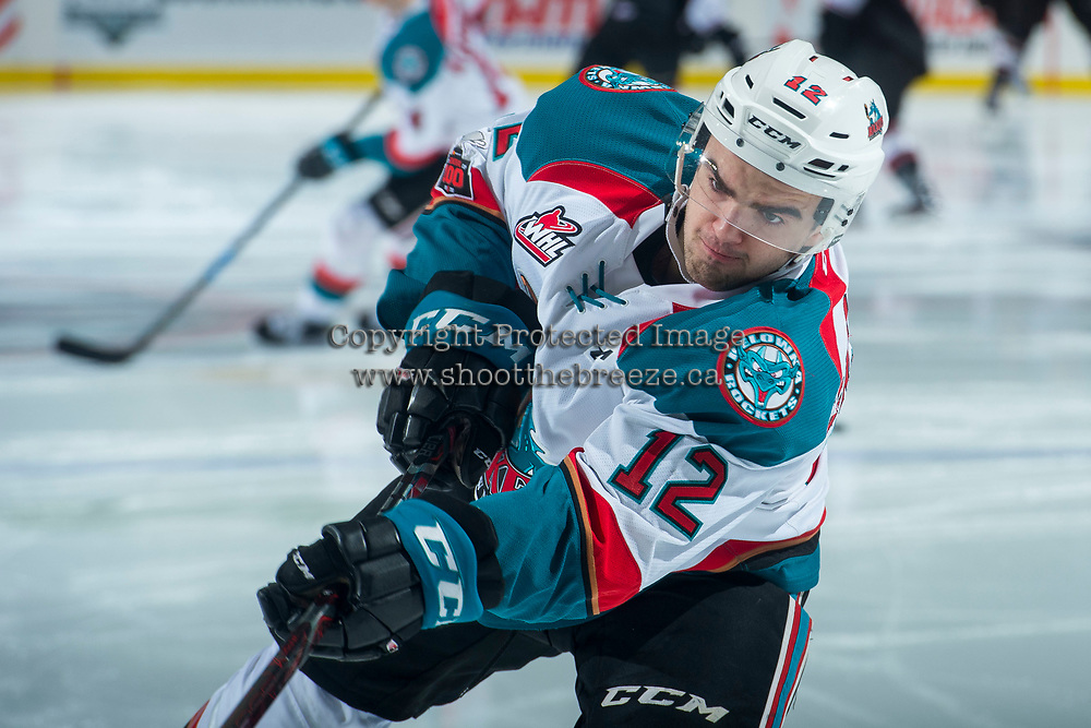 KELOWNA, CANADA - MARCH 7: Erik Gardiner #12 of the Kelowna Rockets warms up against the Vancouver Giants  on March 7, 2018 at Prospera Place in Kelowna, British Columbia, Canada.  (Photo by Marissa Baecker/Shoot the Breeze)  *** Local Caption ***
