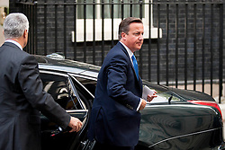 © Licensed to London News Pictures. 12/09/2012. LONDON, UK. The British Prime Minister, David Cameron, arrives at Number 10 Downing Street in London today (12/09/12) after Prime Ministers Questions. Photo credit: Matt Cetti-Roberts/LNP