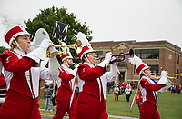 The Laconia High School marching band starts off the parade Friday during Homecoming festivities.  (Karen Bobotas/for the Laconia Daily Sun)