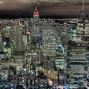 Night view of Midtown Manhattan from the Rockefeller Center observation deck, looking toward the Empire State Building