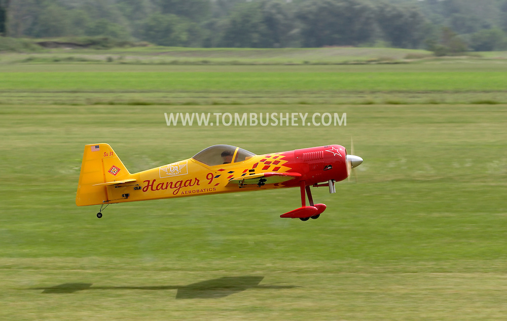 New Hampton, New York - A remote controlled airplane takes off from the grass at a fly-in sponsored by the Wawayanda Flying Club on June 5, 2010.