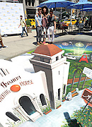 SoCal natives Brandy Norwood, center, Nate Berkus, right, and Jeremiah Brent, left, interact with 3D art to celebrate the launch of #VisitAnaheim and the city's revitalization campaign, Wednesday, June 24, 2015, in New York.  Brought to life by renowned 3D street artist Joe Hill, Anaheim is home to some of California's most exciting attractions, entertainment and sports venues, theme parks and brew scene. To learn more go to www.visitanaheim.org.  (Photo by Diane Bondareff/Invision for Visit Anaheim/AP Images)