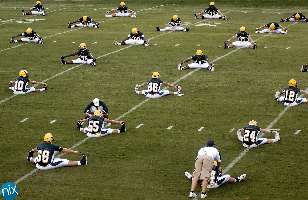 The Central Cabarrus football team stretches prior to its game against Northwest Cabarrus Friday night.