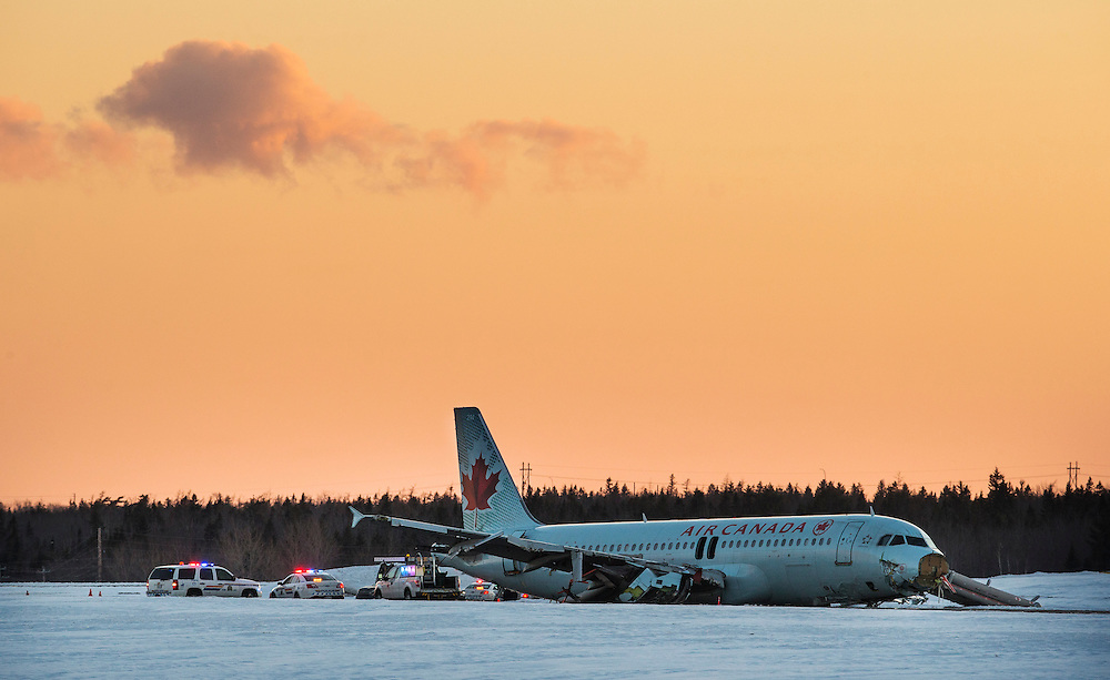 Crews work on the an Airbus A320 that slid off a runway at the end of Air Canada Flight 624 at Halifax Stanfield Airport in Enfield, Nova Scotia, March 29, 2015.  An Air Canada plane slid off a runway and suffered heavy damage while landing in the east coast city of Halifax on Sunday, sending more than 20 passengers and crew to hospital with non-life threatening injuries. The incident happened shortly after midnight. The airline said in an update on Sunday afternoon that all but one of those admitted to hospitals had now been released.   REUTERS/Mark Blinch