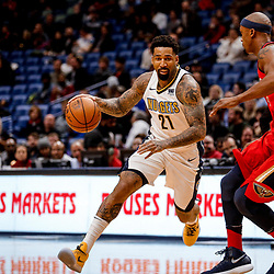 Dec 6, 2017; New Orleans, LA, USA; Denver Nuggets forward Wilson Chandler (21) drives past New Orleans Pelicans forward Dante Cunningham (33) during the first quarter at the Smoothie King Center. Mandatory Credit: Derick E. Hingle-USA TODAY Sports