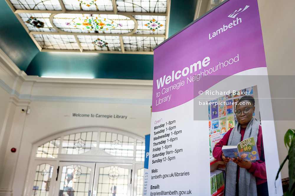 Entrance of the re-opened Carnegie Library on Herne Hill in south London which has opened its doors for the first time in almost 2 years, on 15th February 2018, in London, England. Closed by Lambeth council and occupied by protesters for 10 days in 2016, the library bequeathed by US philanthropist Andrew Carnegie has been locked ever since because, say Lambeth austerity cuts are necessary. A gym that locals say they don't want or need has been installed in the listed basement and actual library space a fraction as before and it's believed no qualified librarians will be present to administer it. Protesters also believe this community building will ultimately sold off by Lambeth council for luxury homes.