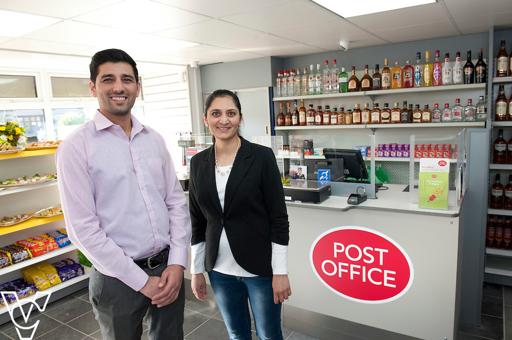 Pictured is postmaster Ray Khunti, left, and Manju Khunti<br /> <br /> Marcus Jones MP has cut the ribbon to officially open the modernised Ansley Road Post Office, Nuneaton.<br /> <br /> Date: October 9, 2015