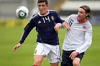 Football - International Under 21 Friendly - Scotland U21 vs. Norway U21<br /> <br /> Scotland vs Norway U21<br /> International Challenge Match, New St Mirren Park, Paisley.<br /> Ross Perry of Scotland challenges Jo Inge Berget of Norway<br /> 10th August 2011<br /> <br /> Ian MacNicol/Colorsport