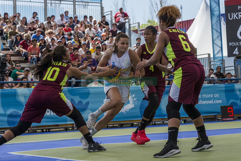 October 8, 2018 - City Of Buenos Aires, City of Buenos Aires, Argentina - SPORTS. City of Buenos Aires, Argentina, October 8, 2018.- ANZHELIKA LIASHKO of Ukraine tryies to dodge the competitors of Venezuela number 10 JAIRENNYS RIAS, 4 ODETH BETANCOURT and 6 LUISANNY ZAPATA at Basketball 3x3 on day two of Buenos Aires 2018 Youth Olympic Games at Urban Park on October 8, 2018 in City of Buenos Aires, Argentina. (Credit Image: © Julieta Ferrario/ZUMA Wire)