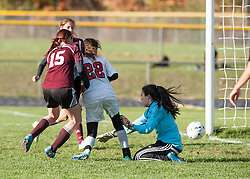 Belmont forward Emma Chase slips the ball past Derryfield's goalie at Belmont High School on Wednesday, October 26, 2016.  (Alan MacRae/for the Laconia Daily Sun)