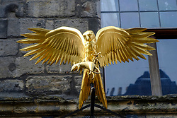 Golden bird outside Gladstone's Land original old tenement building at Lawnmarket in Edinburgh Old Town, Scotland, UK