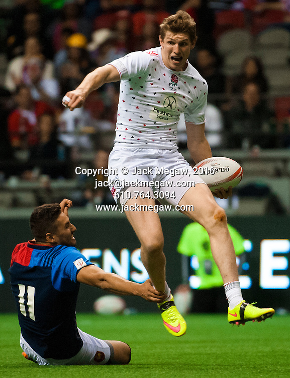 Ruaridh McConnochie of England is tap tackled by Sacha Valleau of France during the pool stages of the 2016 Canada Sevens leg of the HSBC Sevens World Series Series at BC Place in  Vancouver, British Columbia. Saturday March 12, 2016.<br /> <br /> Jack Megaw<br /> <br /> www.jackmegaw.com<br /> <br /> 610.764.3094<br /> jack@jackmegaw.com